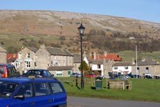 view from immediately outside of half moon house holiday cottage showing the green in the village of reeth in north yorkshire